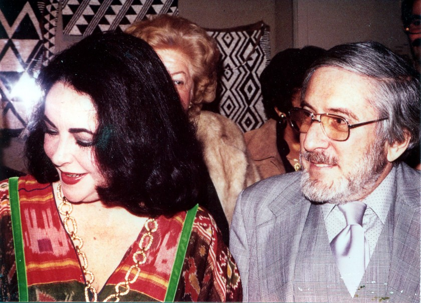 Actress Liz Taylor with NMAfA founder Warren Robbins at the opening of Traditional and Contemporary Crafts from Botswana (Exhibition, 1978) at the Museum of African   Art. Taylor and her husband Sen. Warner were honored at the opening.