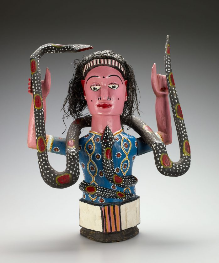 Anang artist, Nigeria Mami Wata figure Late 20th century Wood, paint, raffia 67.5 x 53 x 28 cm (26 9/16 x 20 7/8 x 11 in.) Gift of Flora Edouwaye S. Kaplan, 2009 16 1
