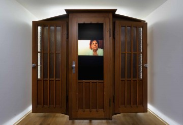 Dimitri Fagbohoun b. 1972, Benin Refrigerium 2014 Wood confessional, broom, book, screws, ceramic objects, electroluminescent paper, frame, inverter, video with sound (5 min. 38 sec.) 210 x 240 x 95 cm (82 5/8 x 94 1/2 x 37 3/8 in.) Collection of the artist