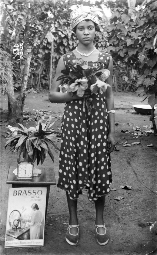 Woman standing with flowers