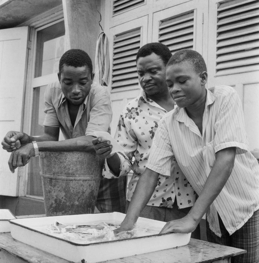 Alonge's assistants washing prints outside the Ideal Studio