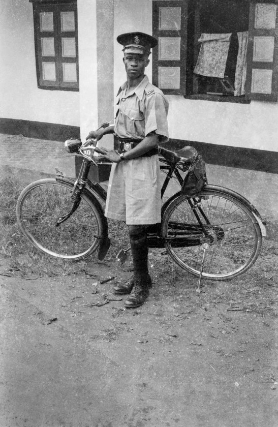 Policeman with bicycle