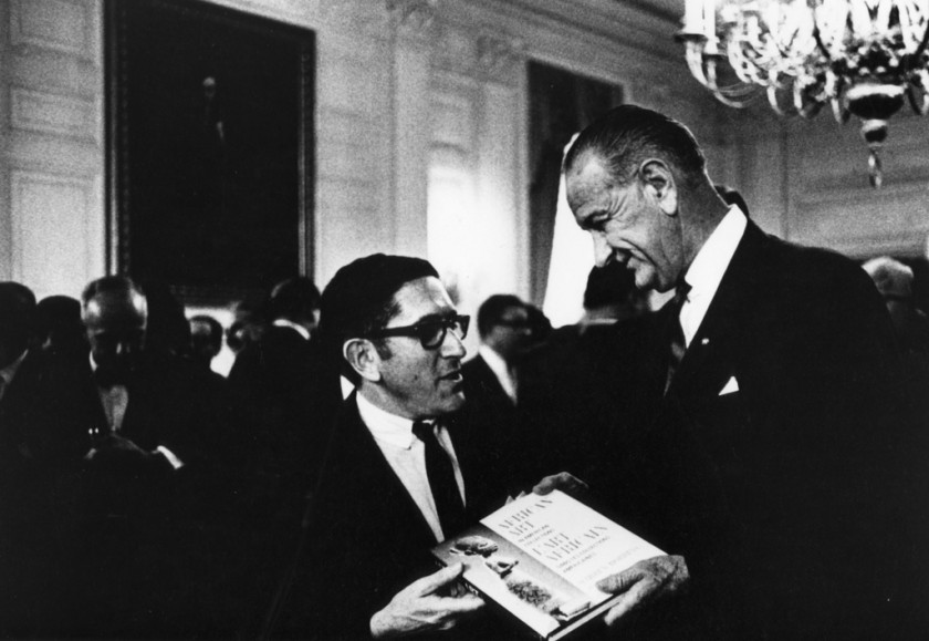 Warren M. Robbins presenting President Lyndon Johnson with a copy of his book, African Art in American Collections, 1964