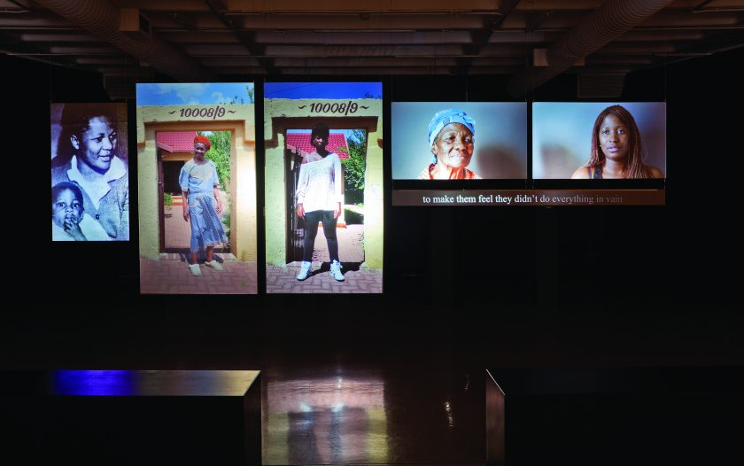 Sue Williamson b. 1941, England There's Something I Must Tell You Installation view, Caroline Motsoaledi and Busisiwe Khatibe  2013 Six-channel rear projection video (36 min.) Image courtesy the artist and Axis Gallery, New Jersey and New York